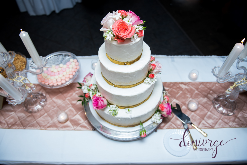 Elegant Gold and Coral Wedding Cake in Hays Kansas