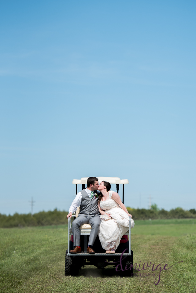 bride and groom leaving ceremony on a golf cart