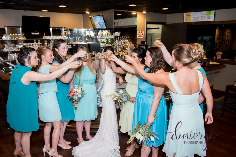bride and bridesmaids at bar