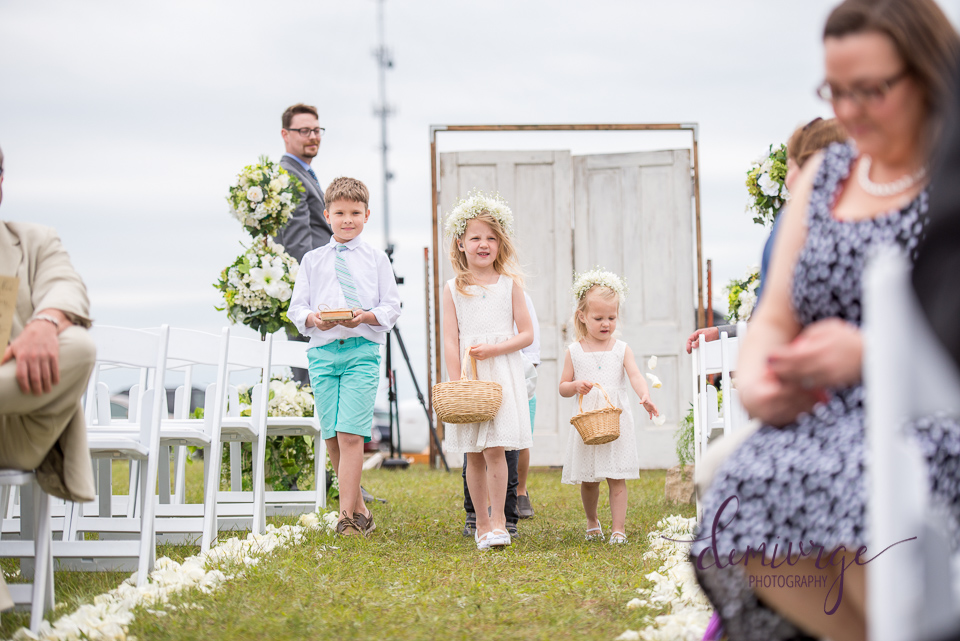 flower girls and ring bearer at outdoor wedding