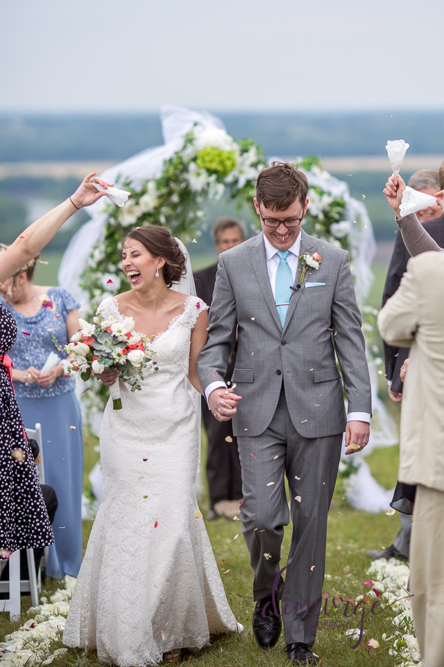 throwing flower pedals during bride and groom wedding recessional