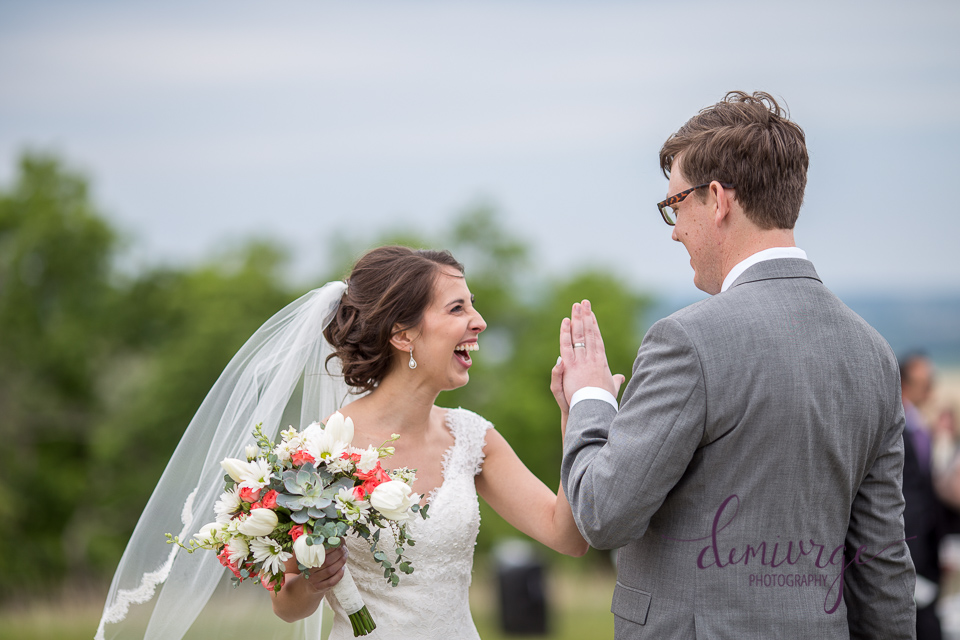 bride and groom giving a high-five after they were married