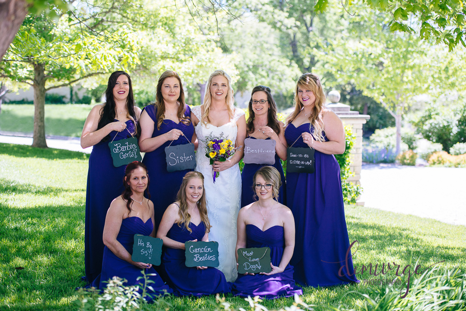 bride with bridesmaids and chalkboard signs