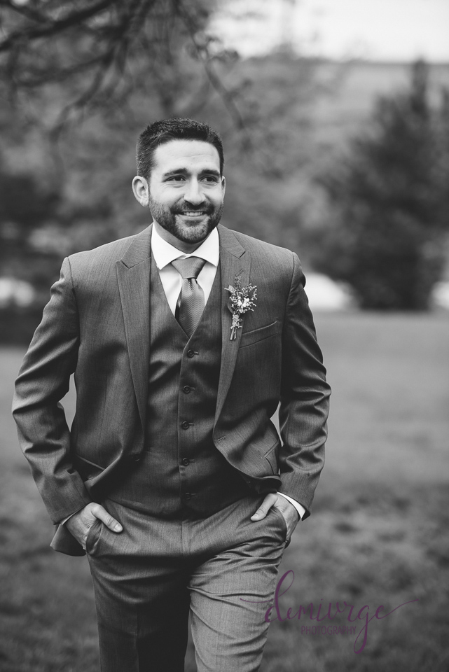 candid groom portrait black and white