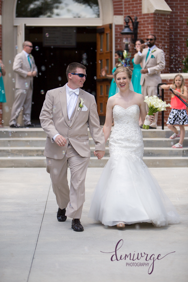 bride and groom exit from catholic church