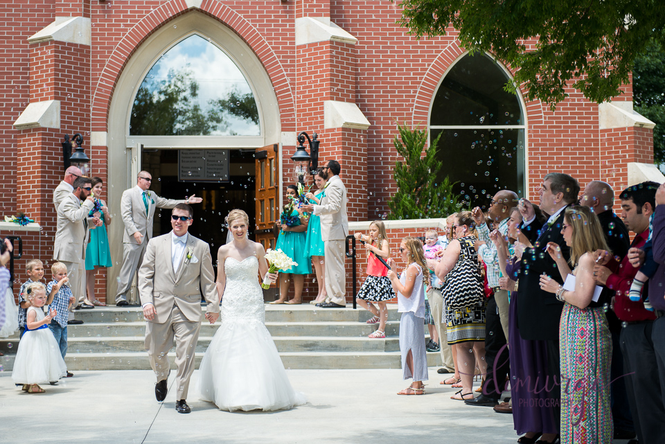 bride and groom bubble exit from church