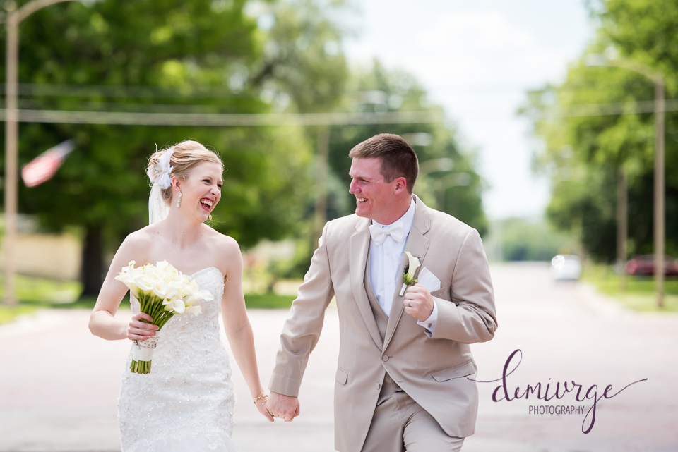 bride and groom running down main street seneca kansas