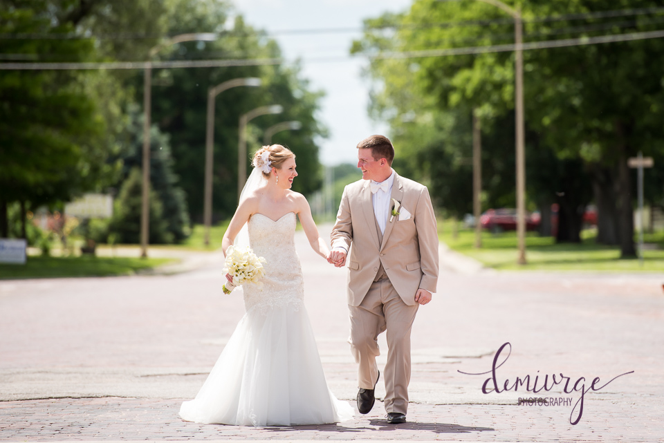 bride and groom on main street seneca wedding photographer