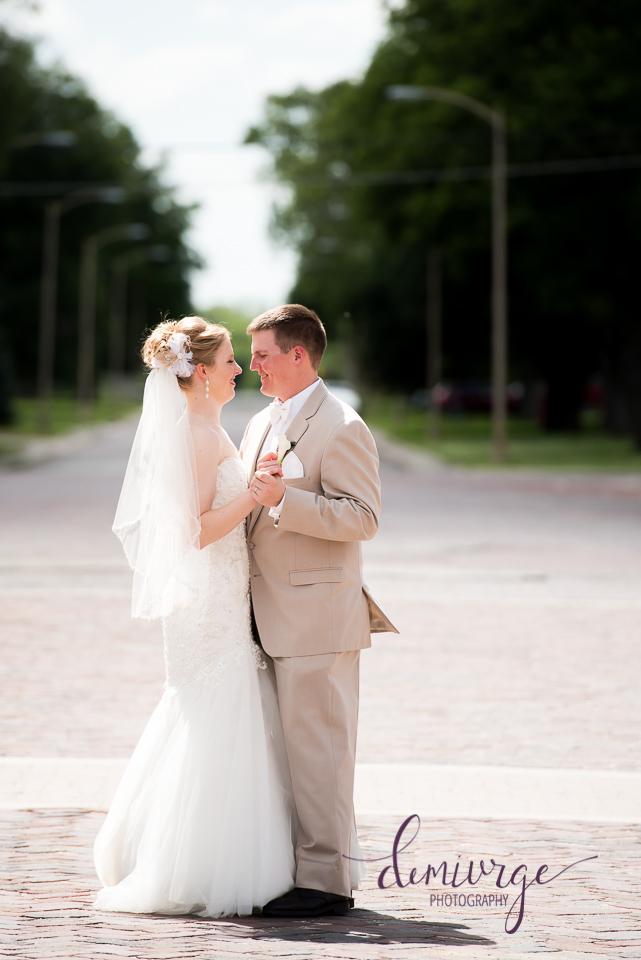 bride and groom dancing on main street