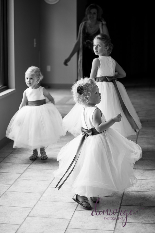 flower girls dancing in hallway bern community center
