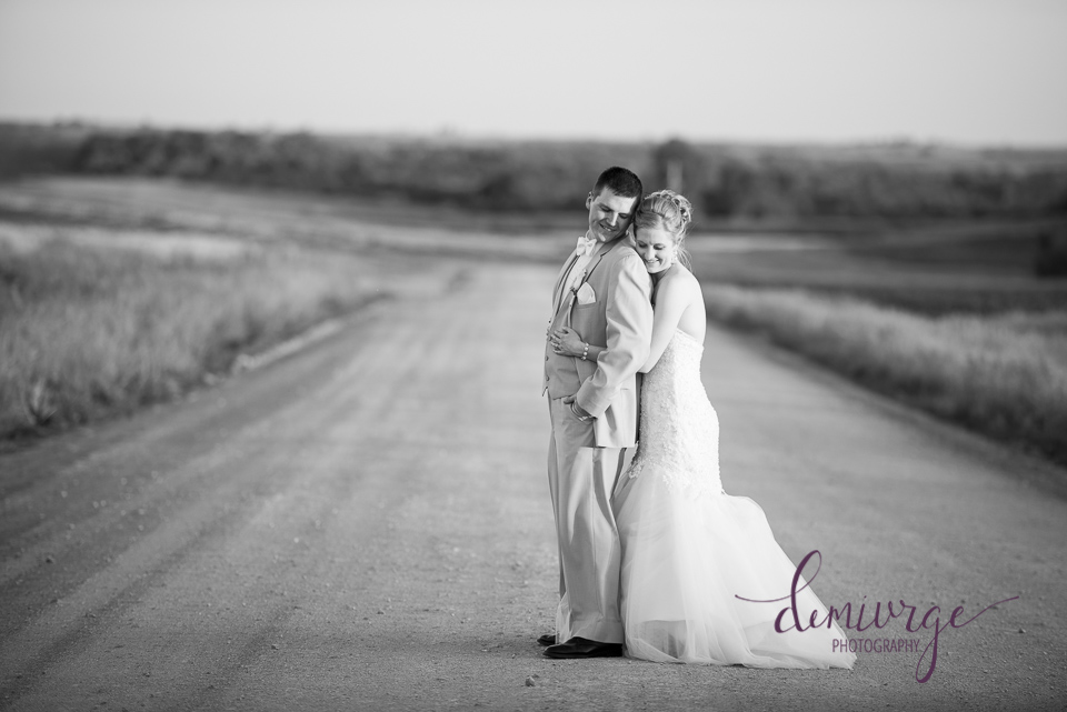 black and white sunset dirt road bride and groom portrait