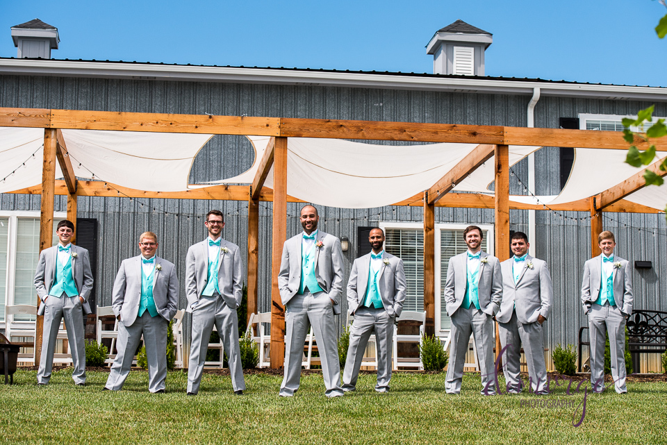 fun outdoor groomsmen photo