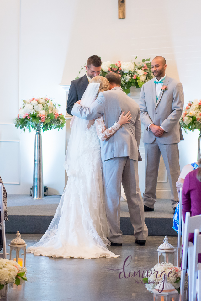 dad giving away bride on wedding day